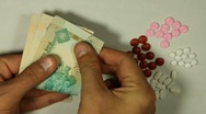 Emirati Dirham AED, Counting Drugs and Money, Health Care, Colorful Pills Stock Footage