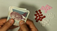 Cambodian Riel KHR, Counting Drugs and Money, Health Care, Colorful Pills Stock Footage