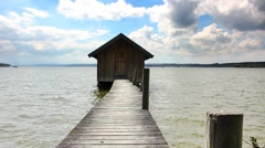 Boathouse with footbridge Stock Footage