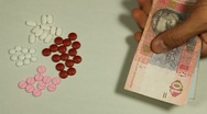 Ukrainian Hryvna UAH, Counting Drugs and Money, Health Care, Colorful Pills Stock Footage