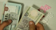 Egyptian Pound EGP, Counting Drugs and Money, Health Care, Colorful Pills Stock Footage