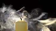 Stock Video Footage of A white candle being blown out, lots of smoke, slow motion.