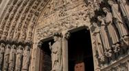 Handheld tilt up facade of Notre Dame Cathedral, Paris, France Stock Footage