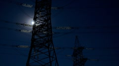 Electricity pylon and moon. - stock footage