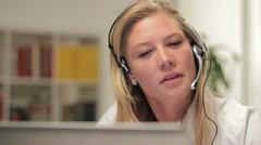 Female telephone customer service operator, happy - stock footage