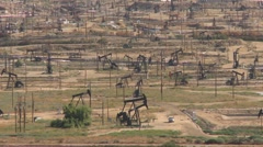 Oil Derricks in Bakersfield California - stock footage