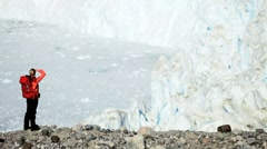 Lone Female on Hiking Expedition by a Glacier Stock Footage