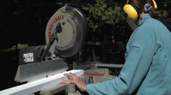 Woman Safely Using Miter Chop Saw for Woodworking Stock Footage