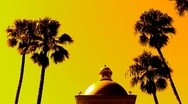 Stock Video Footage of San Diego Hotel Rotunda with Palm Trees and Sunset
