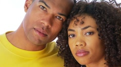 Close up of African-American couple looking at camera - stock footage