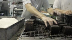 Lavington cakes are dipped in chocolate - stock footage