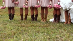 Wedding party (bride and bridesmaids) with their boots on. - stock footage