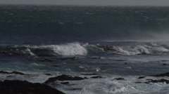 Tracking as a wave comes into shore - stock footage