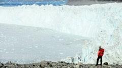 Female Trekking Alone in a Frozen Arctic Landscape Stock Footage