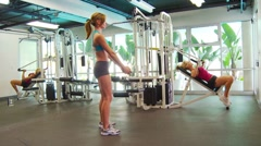 Women working out doing squats, lifting weights Stock Footage