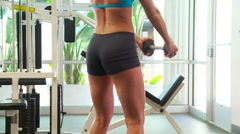 Woman working out doing squats - stock footage