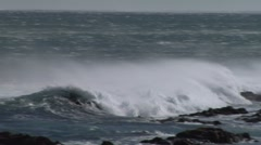 Waves crashing against the shore - stock footage