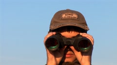Man looking through Binoculars - stock footage