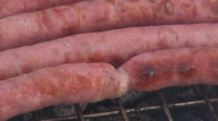 Grilling sausages Stock Footage