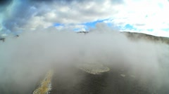Wind Blowing Volcanic Steam from Underground Springs Stock Footage