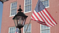 Stock Footage - US Flags flying high in Gettyburg, PA town square Stock Footage