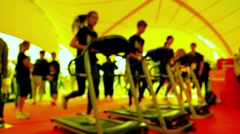 Three people running on treadmill at gym Stock Footage