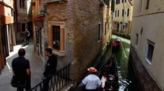 Venice Venezia Veneto narrow street Gondola on canal Stock Footage