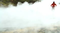 Female on Trekking Expedition Amongst Rising Volcanic Steam - stock footage