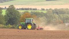 John Deere tractor pulling a roller across a field Stock Footage