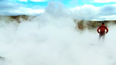 Female on Trekking Expedition Amongst Rising Volcanic Steam Stock Footage