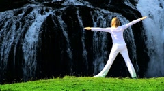 Female in White Performing Yoga Stock Footage