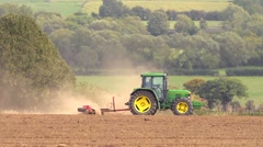 Rolling a field in Autumn, rural industry Stock Footage