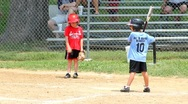 Young boy hitting a baseball. Stock Footage