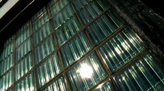 Sunlight on thick glass panels right to left movement Stock Footage