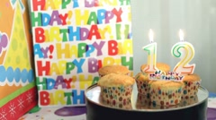 Birthday candles blown out age twelve Stock Footage