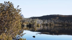 Calm lake with mountain reflection Stock Footage