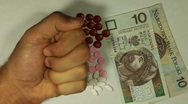 Stock Video Footage of Polish Zloty PLN, Counting Drugs and Money, Health Care, Colorful Pills