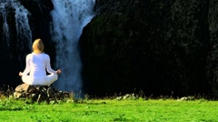 Yoga Exercises at Flowing Waterfall - stock footage