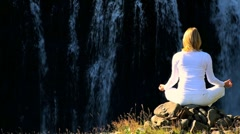 Female Practising Yoga by Waterfall - stock footage