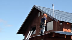 Man installing antenna on roof - stock footage