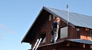 Man installing antenna on roof Stock Footage