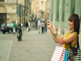 Two happy women taking picture with mobile phone in the city, steadycam shot Stock Footage