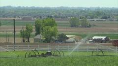 Farmland sprinklers house 1 - stock footage