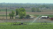 Stock Video Footage of Farmland sprinklers house 1