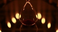 Stock Video Footage of Hourglass with candles reflections