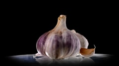 Garlic on black background - stock footage