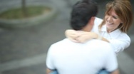 Young couple in love spinning Stock Footage