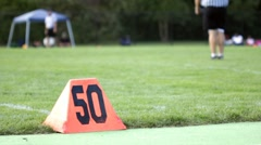 50 yard line at children football game Stock Footage
