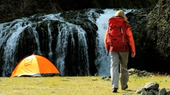 Young Hiker by Tent at Waterfall Stock Footage