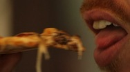 Stock Video Footage of Man eats Pizza